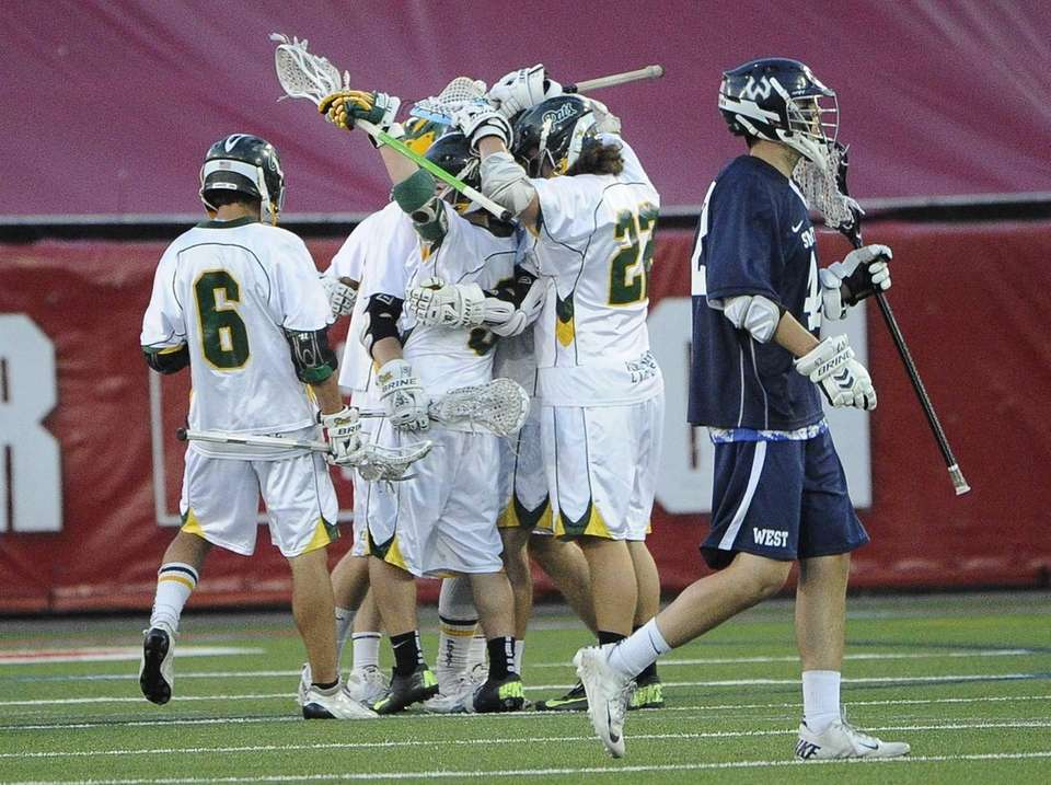 Ward Melville teammates celebrate a goal against Smithtown