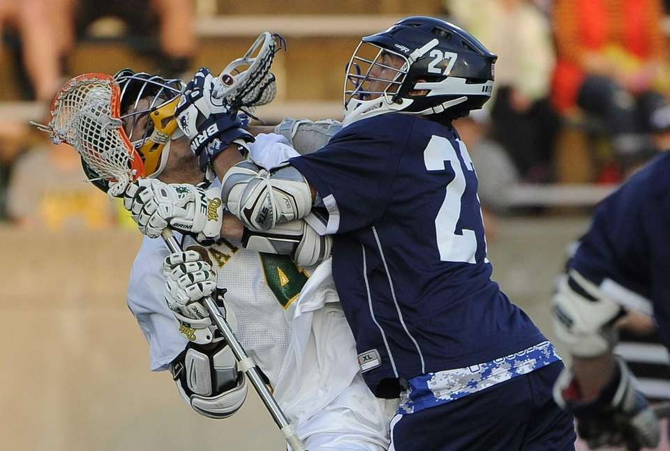 Ward Melville's Daniel Bucaro is checked by Smithtown
