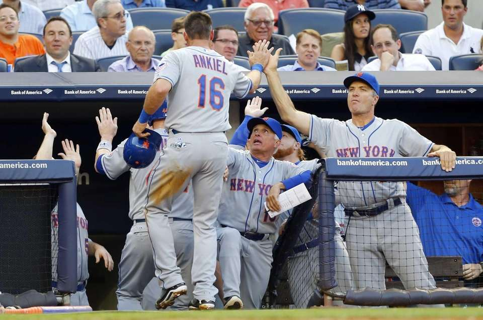 Rick Ankiel of the Mets celebrates with teammates
