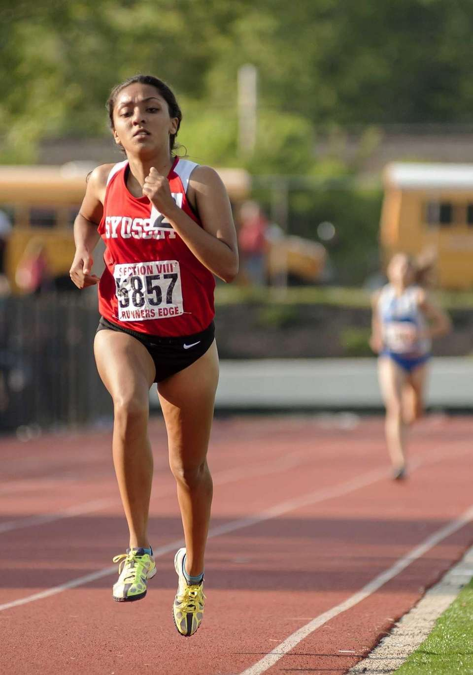 Syosset's Henna Rustami wins the girls 3000 meter