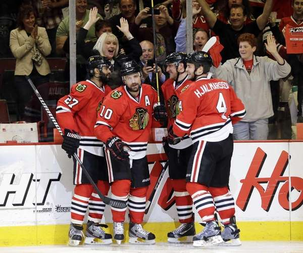 Chicago Blackhawks center Patrick Sharp celebrates with his