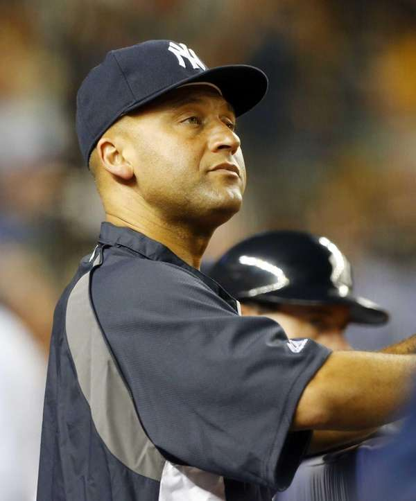 Derek Jeter of the Yankees looks on against