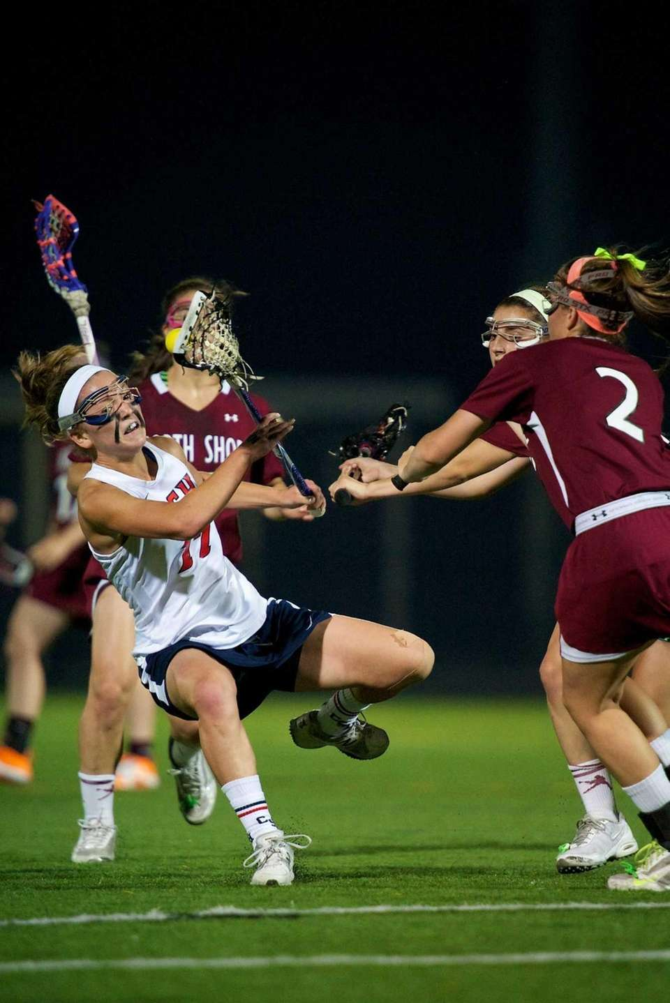 Cold Spring Harbor midfielder Jillian Lee is fouled