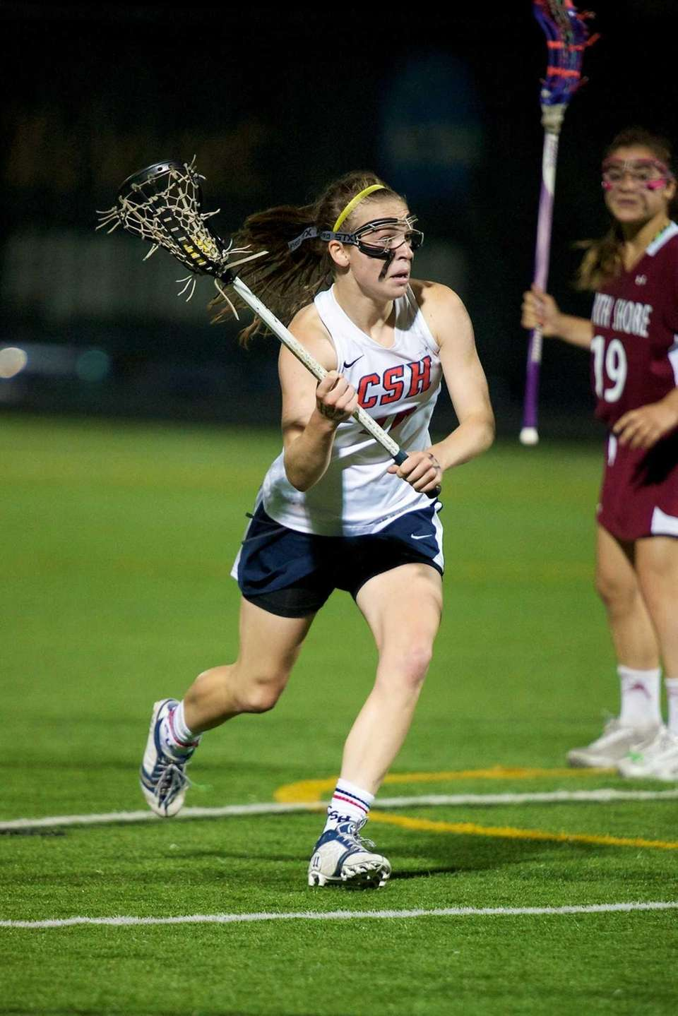 Cold Spring Harbor midfielder Katherine Rueger looks to