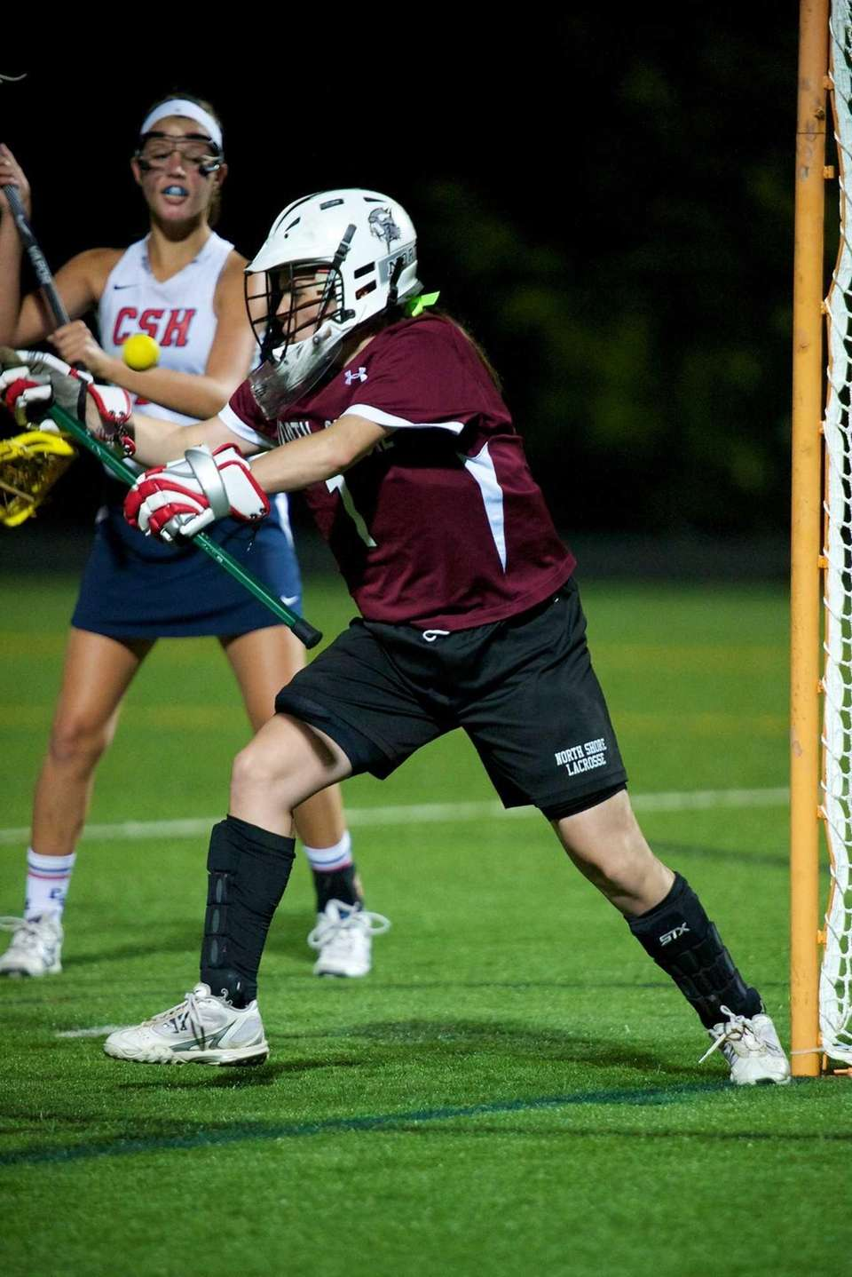 North Shore goalie Alexis Greene stops a shot