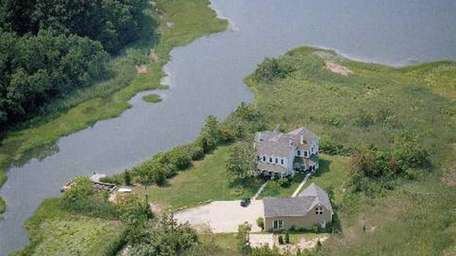On the market in May 2013, this 1.45-acre
