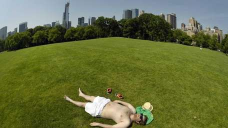 A man takes advantage of the hot weather