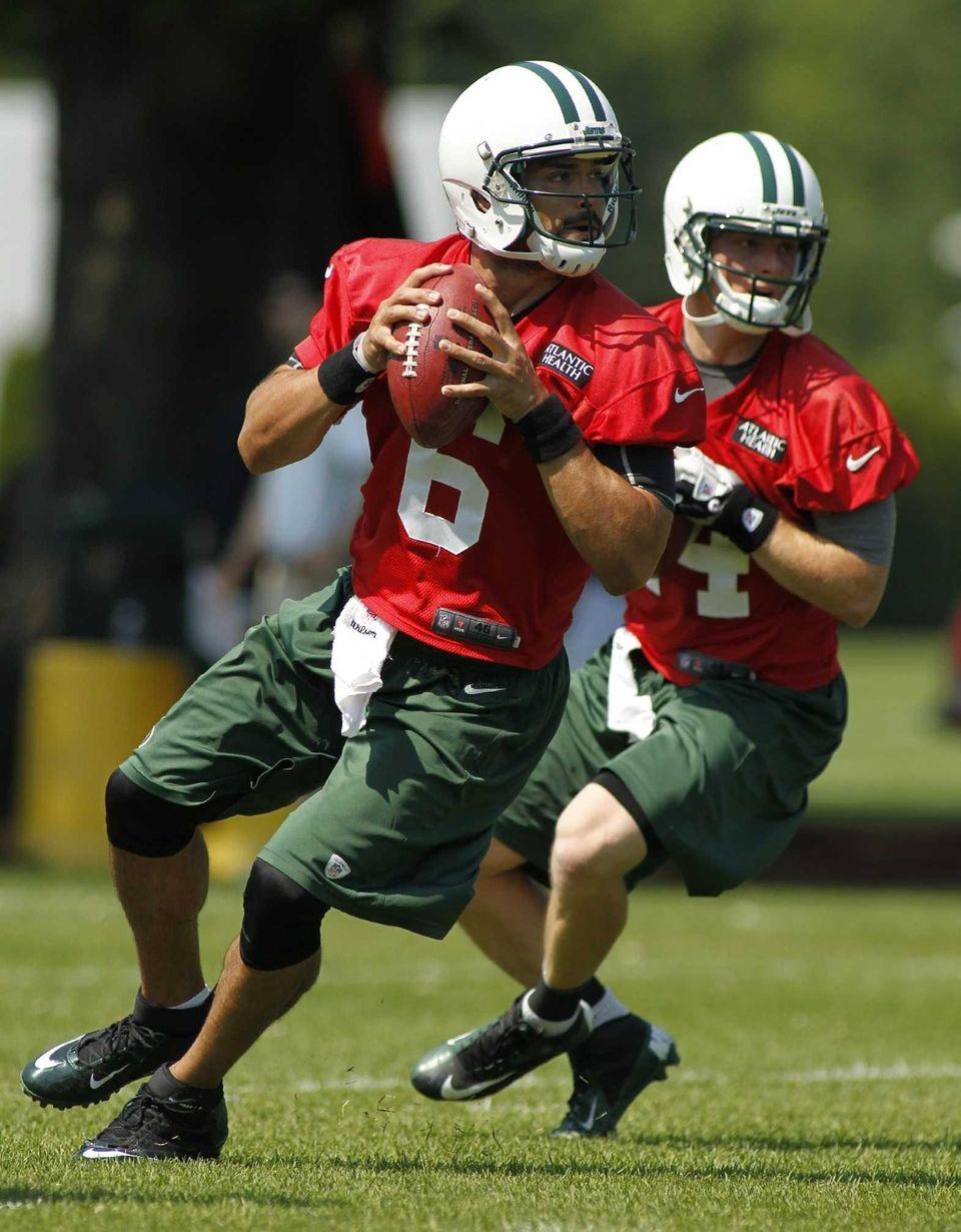 Quarterback Mark Sanchez looks to throw a pass