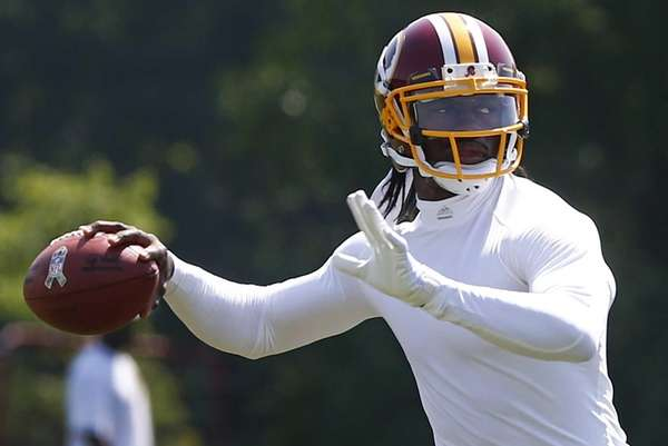 Washington Redskins quarterback Robert Griffin III practices during