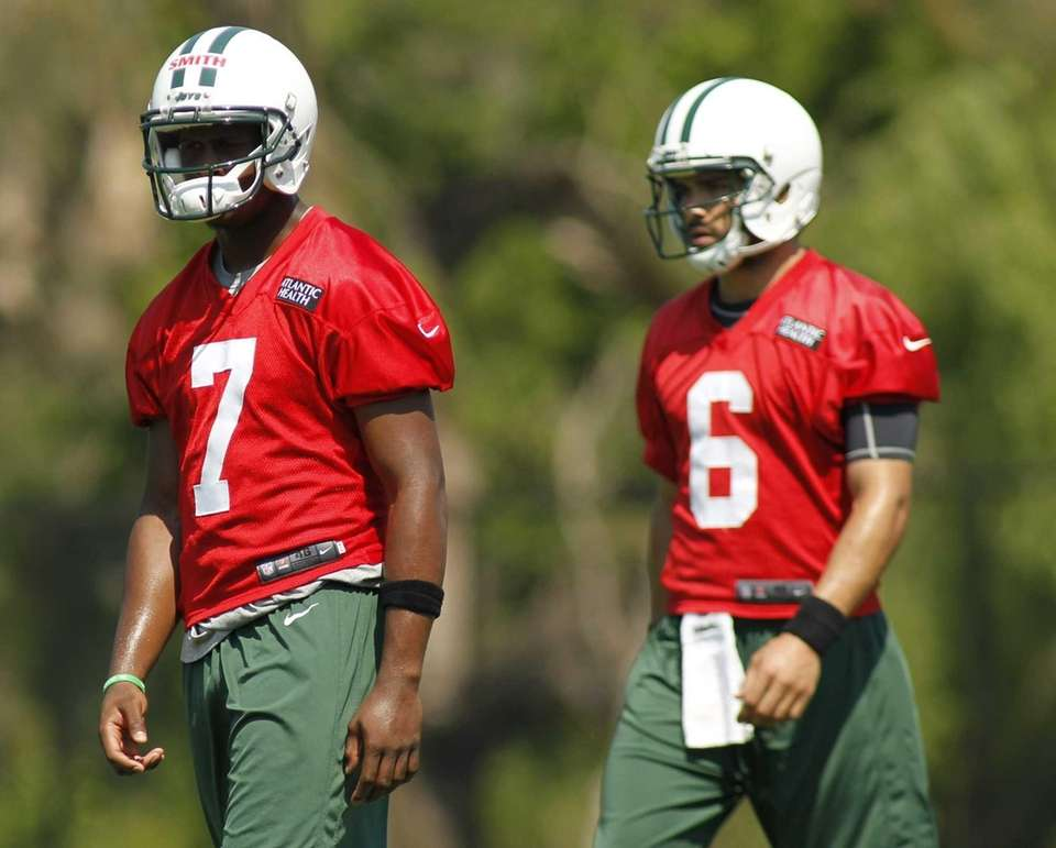 Quarterbacks Mark Sanchez and Geno Smith looks on