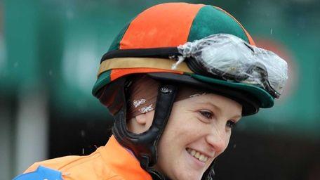 Jockey Rosie Napravnik smiles on her mount before