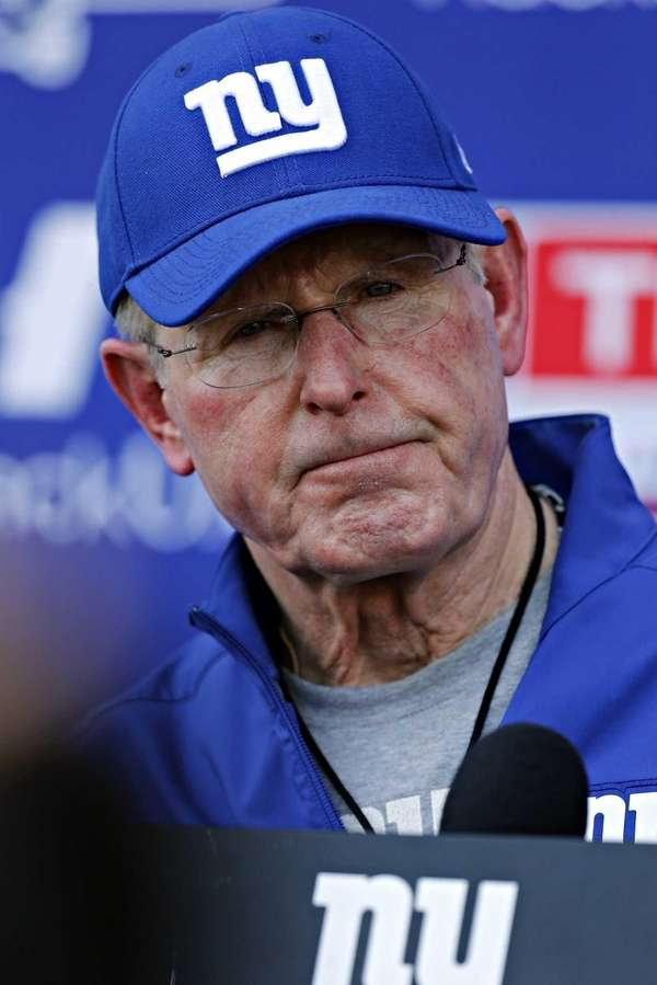 Tom Coughlin answers questions from the media after