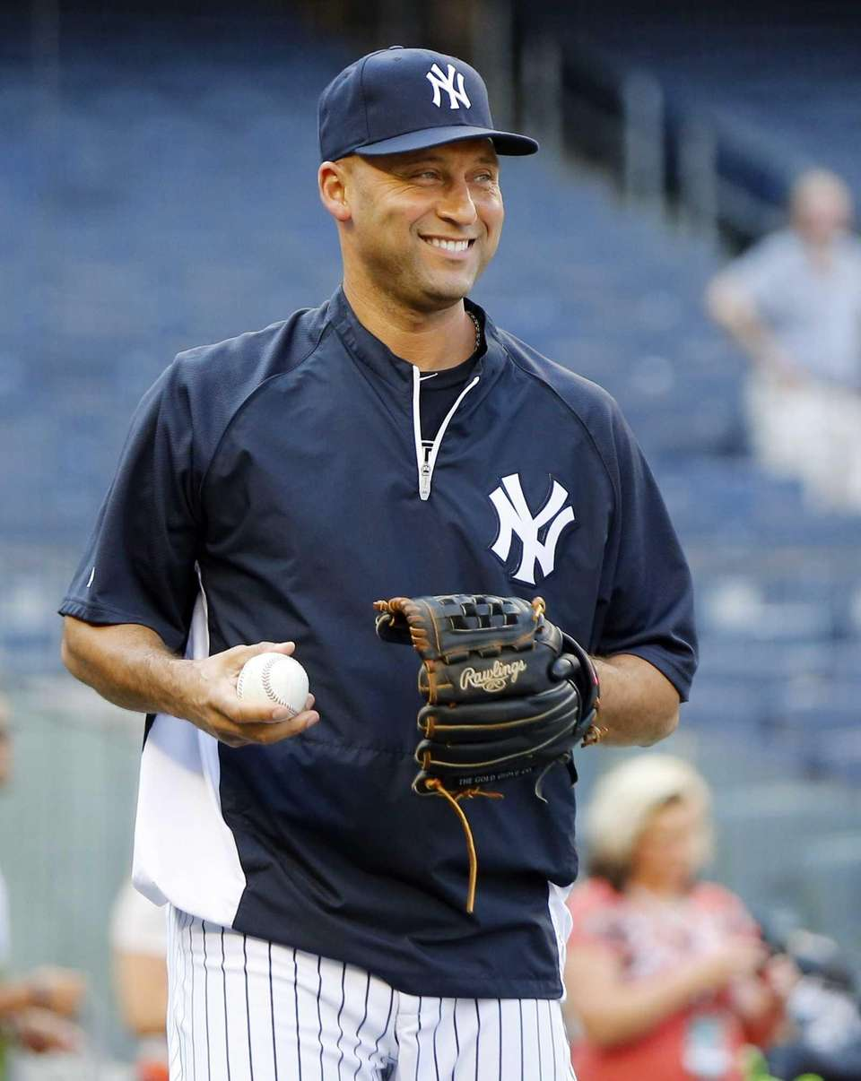 Derek Jeter of the Yankees throws during batting