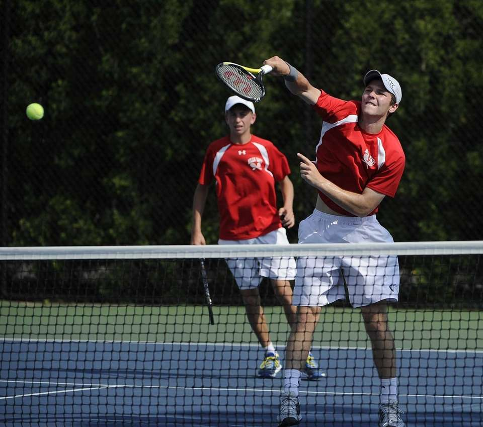 Half Hollow Hills East's Jeff Cherkin returns the