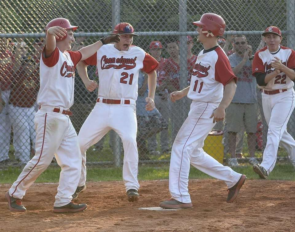 Connetquot's Brian McKean scores the winning run on