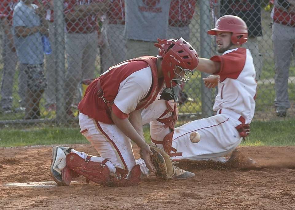 Connetquot's Justin Scala beats the throw to home