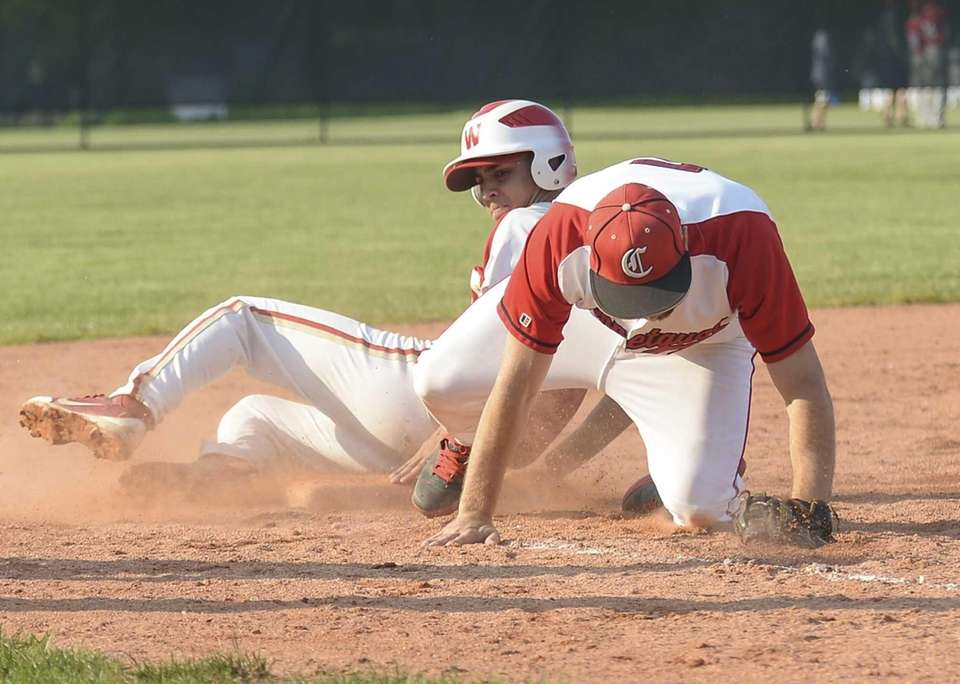 Hills West's Nick Lombardi beats the throw to