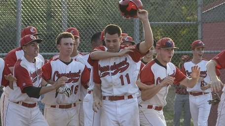 Connetquot's Brian McKean is congratulated as the winning
