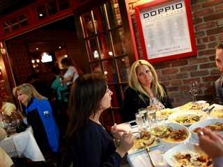 Diners outside of Doppio Artisan Bistro in Huntington.