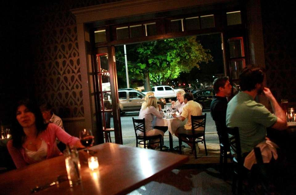 Patrons dine at Doppio Artisan Bistro in Huntington.