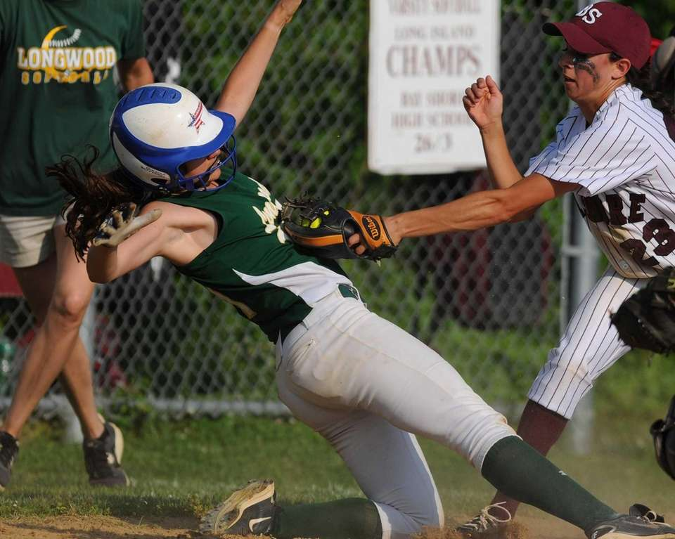 Bay Shore shortstop Giana Panariello, right, tags out