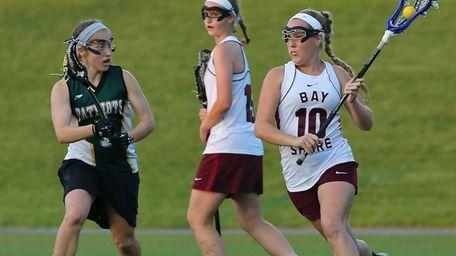 Bay Shore's Kyra Harney moves behind the net