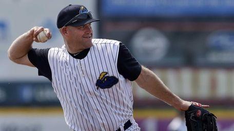 Yankees third baseman Kevin Youkilis throws the ball