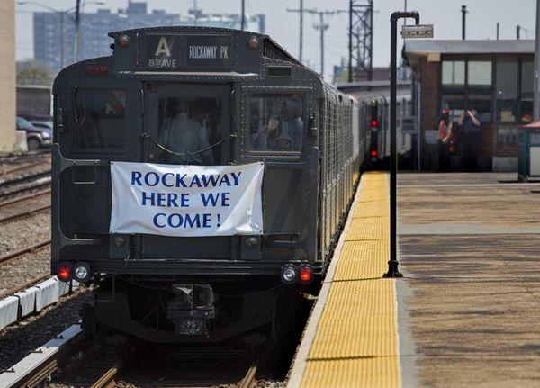A vintage A train departs the Beach 116