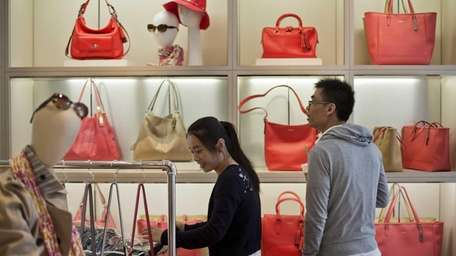 Customers browse at a Coach Inc. store in