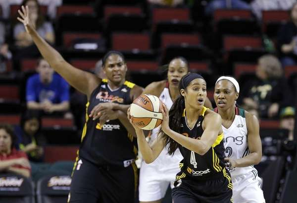 Tulsa Shock's Skylar Diggins looks to pass while