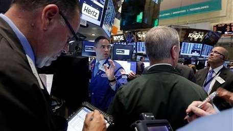 Traders gather on the floor of the New