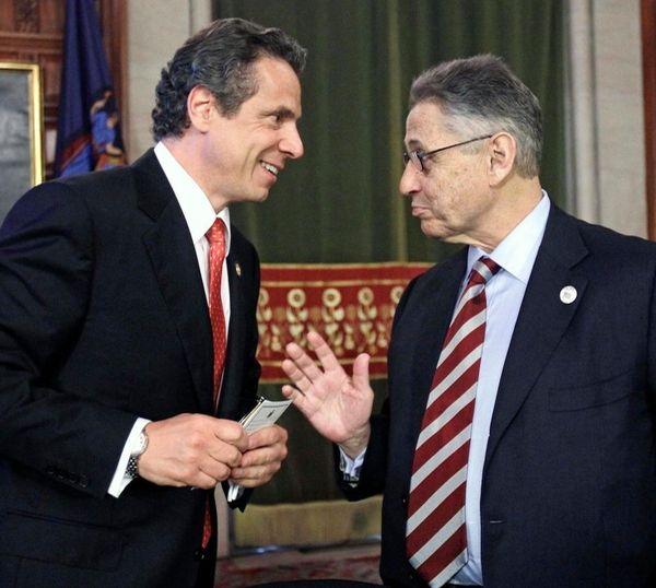 New York Gov. Andrew Cuomo, left, talks with