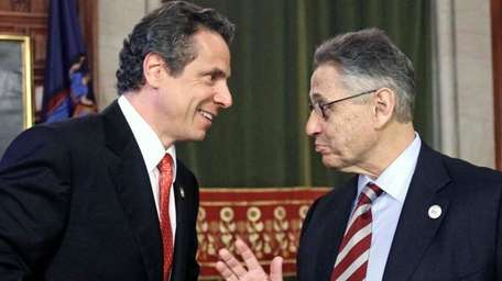 Gov. Andrew M. Cuomo talks with now-former Assembly
