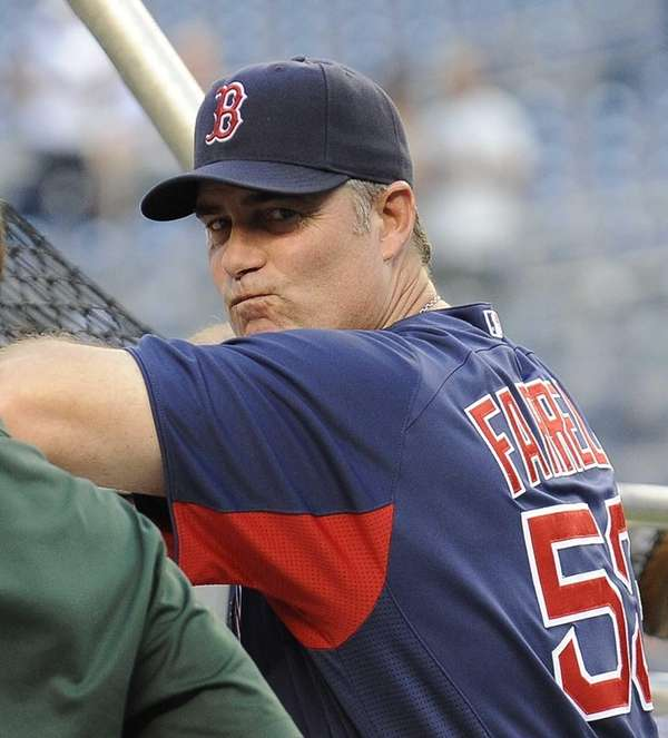 Boston Red Sox manager John Farrell watches from