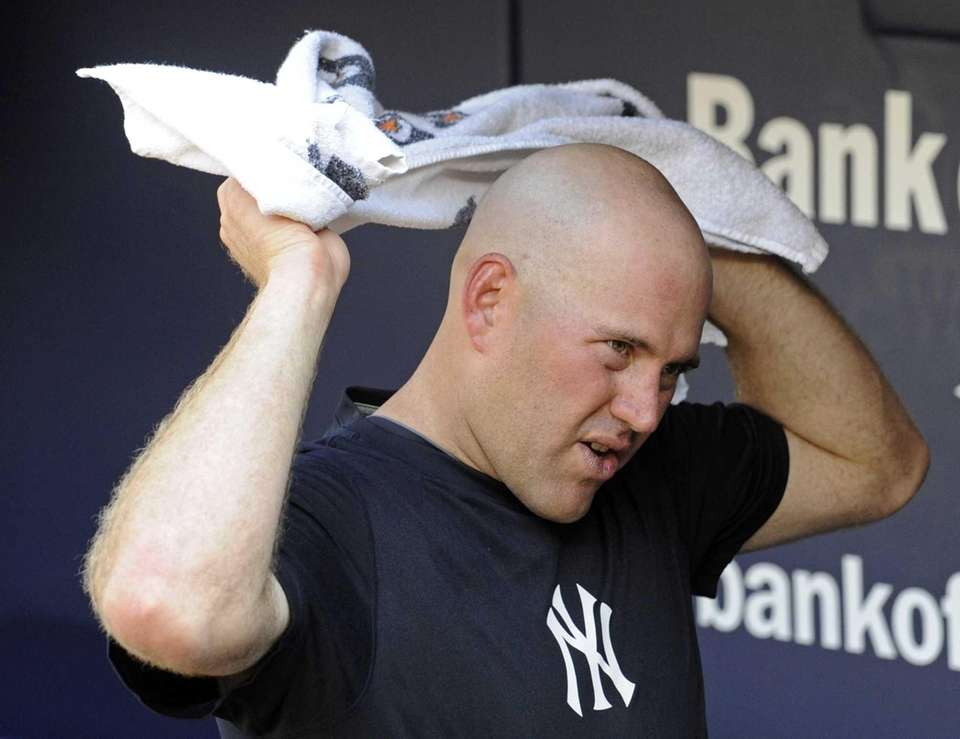 Yankees' Kevin Youkilis towels off before a baseball