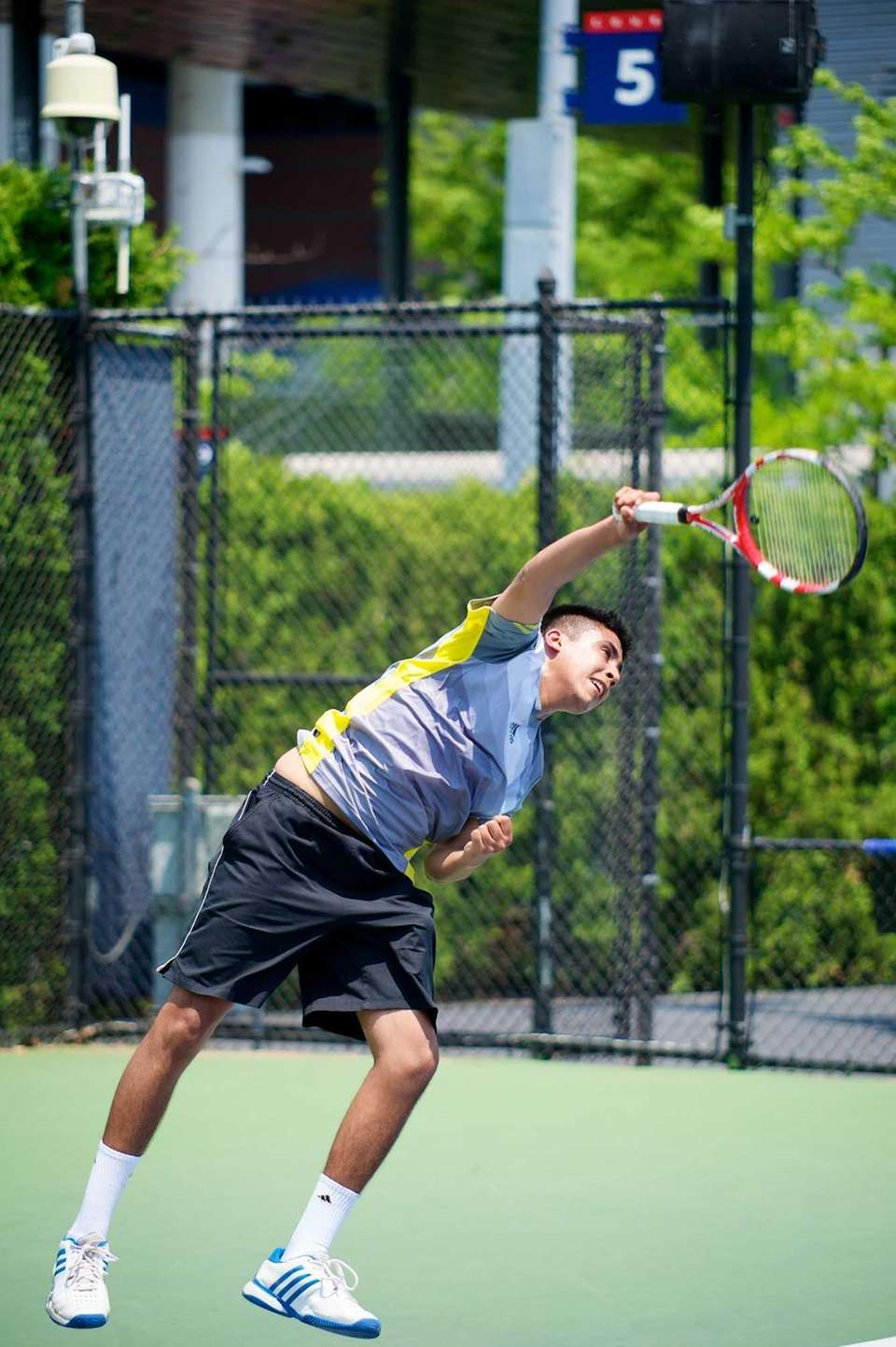 Zain Ali of Half Hollow Hills East serves