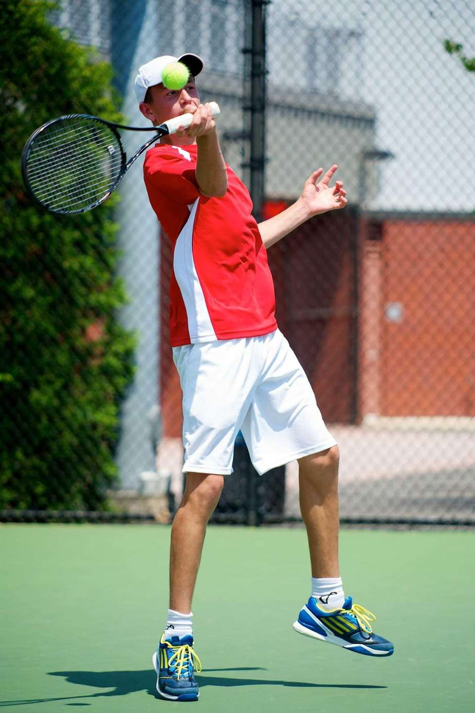 Kyle Apler of Half Hollow Hills East serves