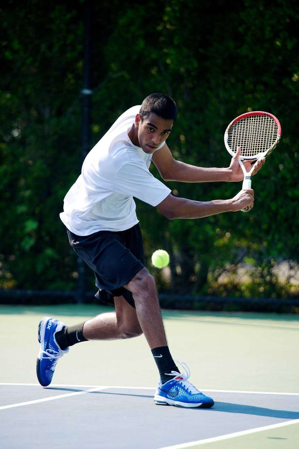Vihar Shah of Herricks hits a backhand slice