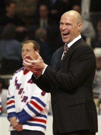 Former Rangers captain Mark Messier, right, reacts during