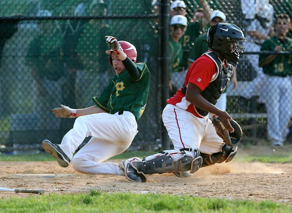 Ward Melville's Mike Miller slides safely into home
