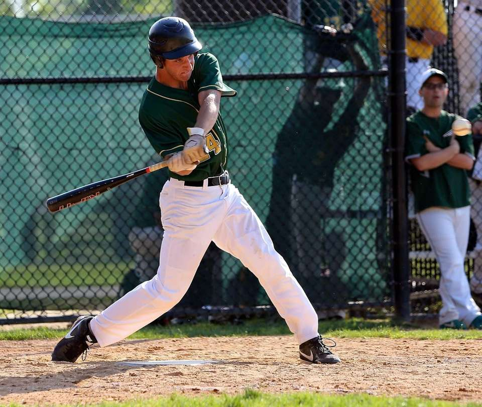 Ward Melville's Joe Flynn drives a two run
