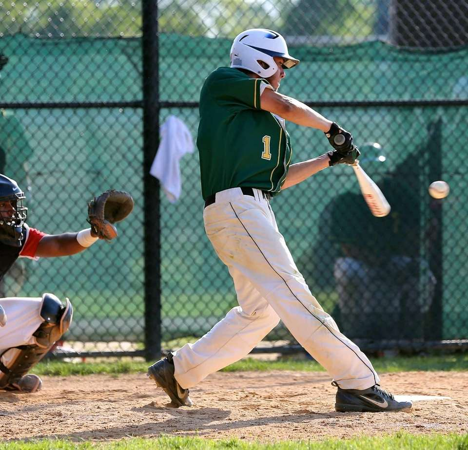 Ward Melville's Anthony Kay drives a single to