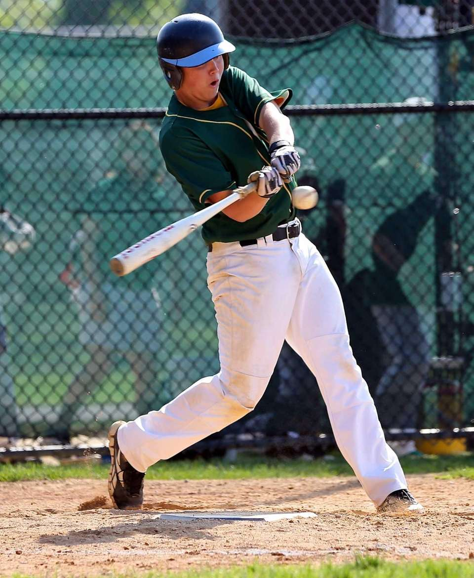 Ward Melville's Phil Carballeira drives a single to