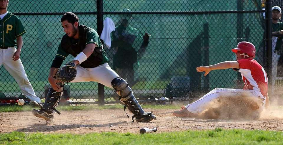 Connetquot's Brian McKean slides home safely as Ward