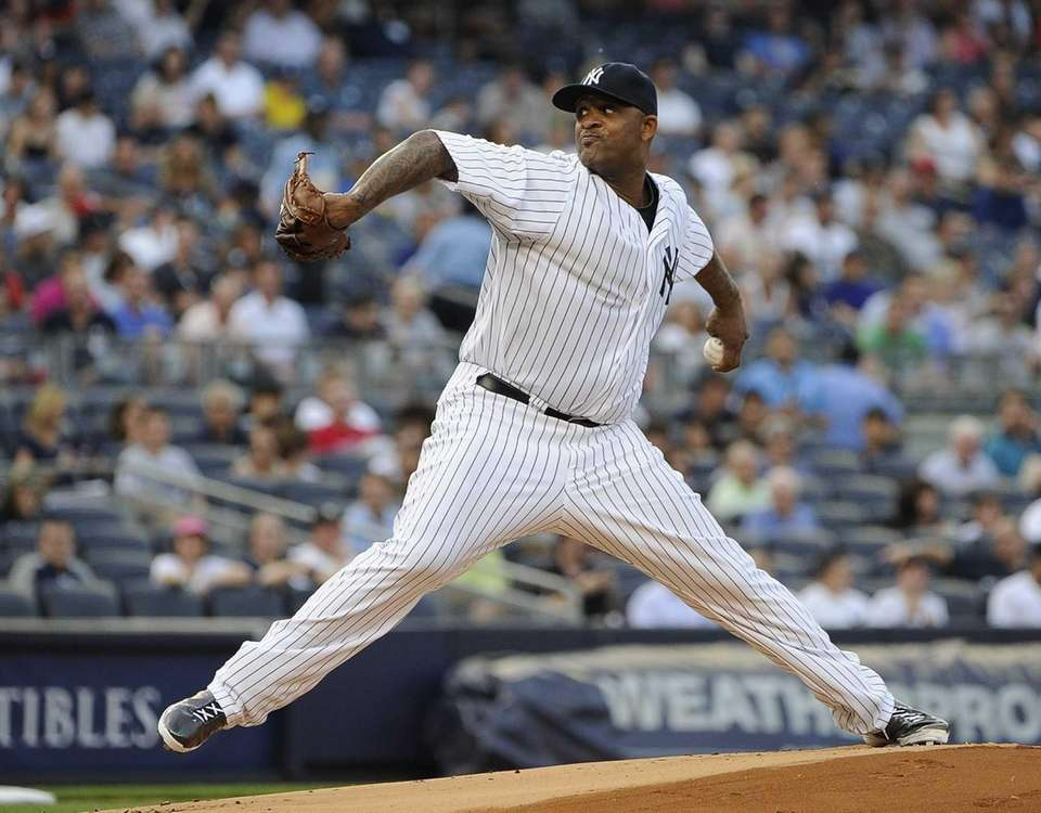 Yankees starting pitcher CC Sabathia delivers in the
