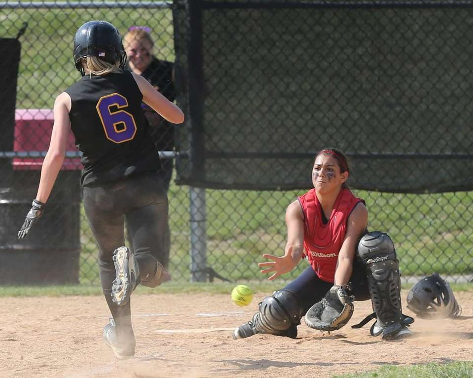 Sayville's Jessica Griffin sprints for home while Miller