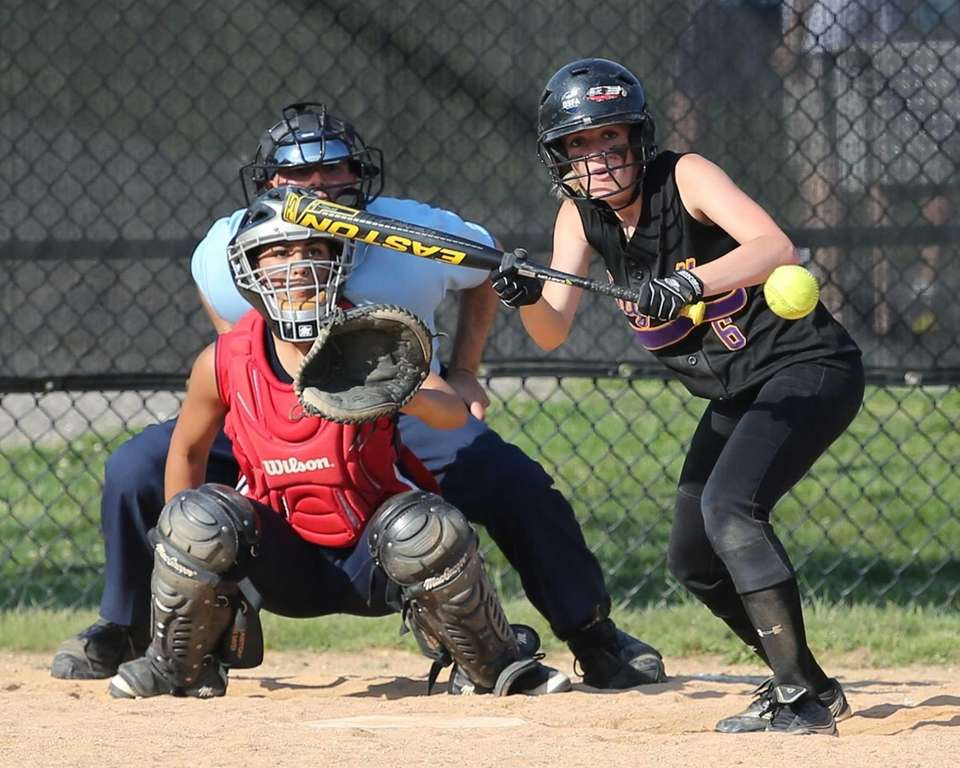 Sayville's Jessica Griffin bunts against Miller Place in