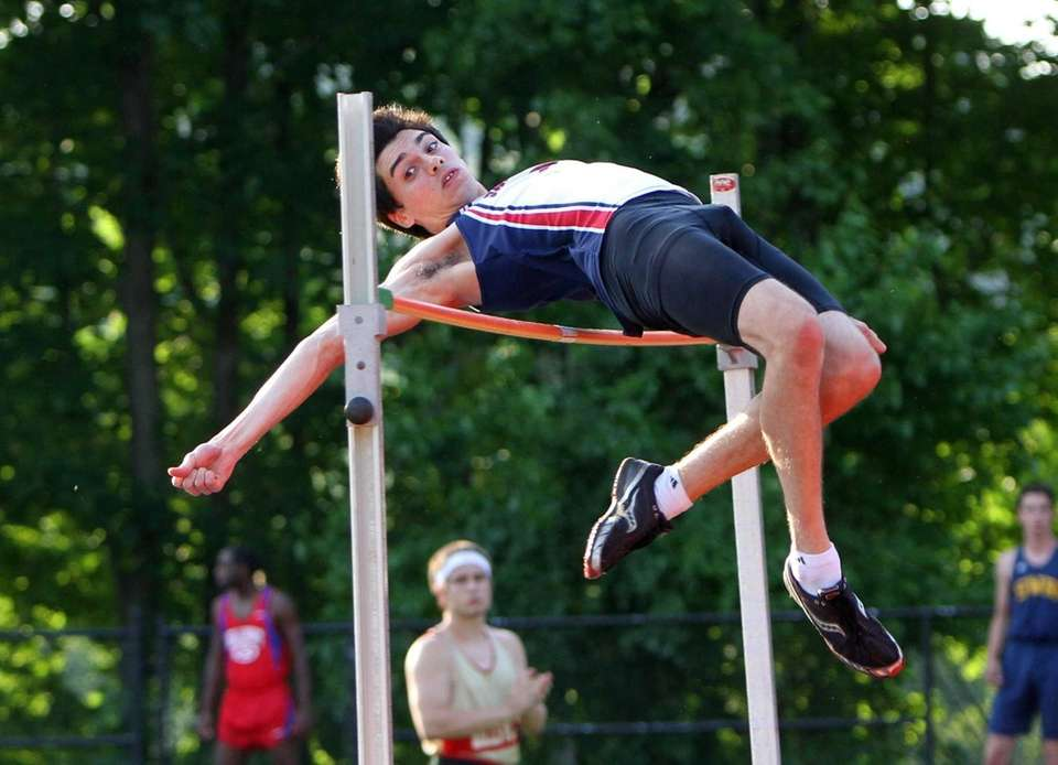 Devin Mirenda of Smithtown West clears the bar