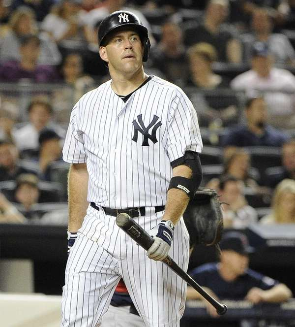 Yankees' Kevin Youkilis reacts after he strikes out