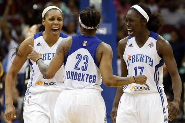 Liberty's Cappie Pondexter celebrates with teammates Plenette Pierson,